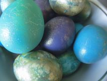 Some colorful eggs in a plate for the Easter. Many colorful eggs in a plate for the Easter holiday stock image