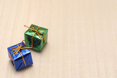 Some colorful gift boxes with gold ribbons. Some colorful gift boxes with gold ribbons on wood Stock Photography