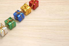 Some colorful gift boxes with gold ribbons. Stock Image