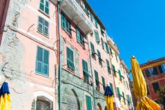 Some colorful houses with yellow umbrellas of Vernazza. View of main square with typical high houses stock photos