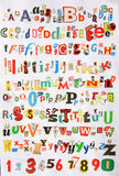 Some colorful newspaper alphabet. A lot of colorful newspaper alphabet isolated on white background Stock Image