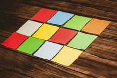 Some Colorful sticky post its. Colorful sticky post its on wooden background Royalty Free Stock Image