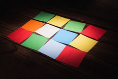 Some Colorful sticky post its. Colorful sticky post its on wooden background stock photos