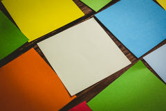 Some Colorful sticky post its. Colorful sticky post its on wooden background Stock Photo