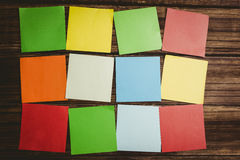 Some Colorful sticky post its. Colorful sticky post its on wooden background stock photography