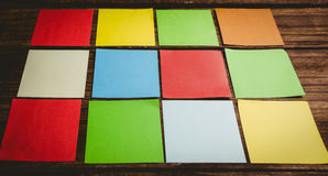 Some Colorful sticky post its. Colorful sticky post its on wooden background stock images