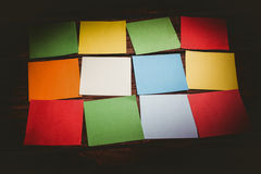 Some Colorful sticky post its. Colorful sticky post its on wooden background royalty free stock photo