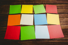 Some Colorful sticky post its. Colorful sticky post its on wooden background royalty free stock photography