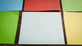 Some Colorful sticky post its. Colorful sticky post its on wooden background royalty free stock images