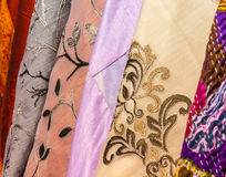 Some coloured silk foulard in market stock. Some coloured silk foulards in market stock Royalty Free Stock Photography