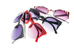 Some coloured sunglasses. On white isolated background Royalty Free Stock Image