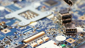 Some computer USB port components. Over motherboard background stock footage