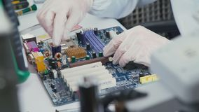 Some computer USB port components over motherboard background. Repair of laptops and computer motherboards. computer repair wizard examines laptop motherboard stock video footage