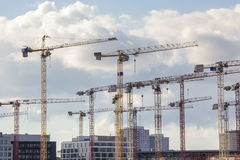 Some construction cranes in berlin city. Some plain construction cranes in berlin city royalty free stock photography