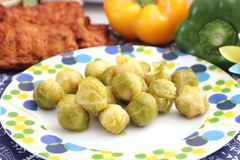Brussels sprouts. Some cooked Brussels sprouts on a plate Stock Photo