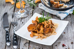 Some cooked Chanterelles. On vintage wooden background Royalty Free Stock Images