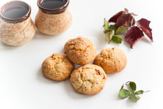 Some cookies. Cookies with raisins and nuts and some autumn leaves Royalty Free Stock Photography