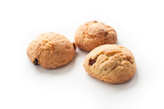 Some cookies on white. Multiple cookies with raisins and nuts on white Royalty Free Stock Photos