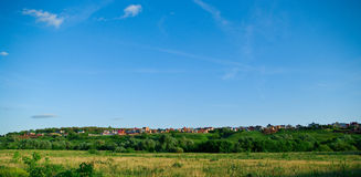 Some cottages on a hill. A summer landscape royalty free stock image