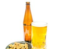 Some crackers and light beer closeup. Crackers and light beer on white closeup Stock Photo