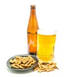 Some crackers and light beer. Crackers and light beer closeup on white Royalty Free Stock Photo