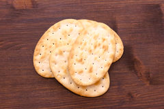 Some crackers oval of wood seen from above. Some crackers oval on a wooden table seen from above Stock Photos