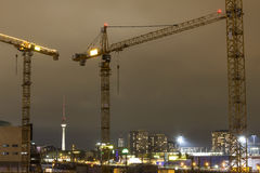 Some cranes in berlin germany at night. Some plain cranes in berlin germany at night royalty free stock photos