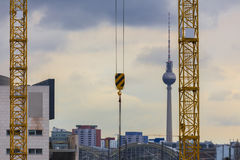 Some cranes in berlin germany. Some plain cranes in berlin germany royalty free stock photography