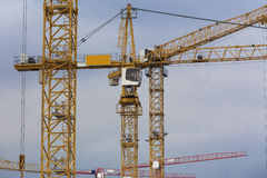 Some cranes in front of a blue sky Royalty Free Stock Image