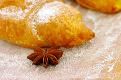 Some croissants. On the wood texture with truestar spices. Focus on the truestar Royalty Free Stock Photography