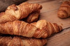 Some croissants on a wooden surface.  Stock Photography