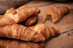 Some croissants on a wooden surface.  Stock Photo