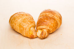 Some croissants on a wooden surface. Some delicious croissants on a wooden surface Stock Photo