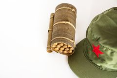 Cuban cigars rolled in banana leaf and military cap with red sta. Some cuban cigars rolled in banana leaf and military cap with red star stock photo