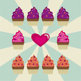 Some cupcakes and a heart on a white and blue background Stock Photo