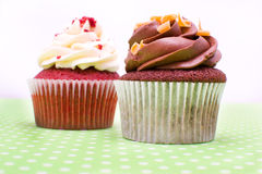 Some cupcakes. Some sweet cupcakes on green background stock photography