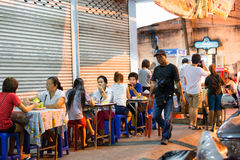 Some customers are sitting at the restaurant tables. PHUKET, THAILAND - APRIL 26, 2015: Some customers are sitting at the restaurant tables Royalty Free Stock Photos