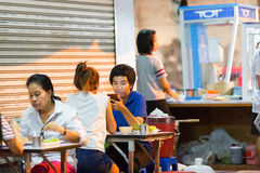 Some customers are sitting at the restaurant tables. PHUKET, THAILAND - APRIL 26, 2015: Some customers are sitting at the restaurant tables Royalty Free Stock Images