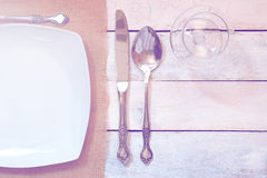 Some cutlery on a white wooden table. Empty copy space for Editor's text. Top view Stock Photo