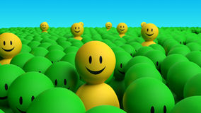 Some 3d yellow men come out from a green crowd Royalty Free Stock Image