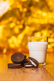 Some dark glass of milk and cookies on a blurred background. Some dark glass of milk and cookies on a blurred  background Stock Image