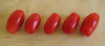 Some fresh date-tomatoes. Some date-tomatoes on a desk stock photo