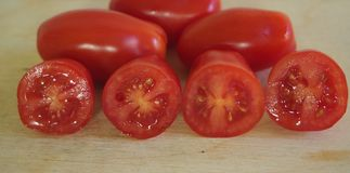 Some date-tomatoes. On a desk royalty free stock image