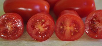 Some date-tomatoes. On a desk royalty free stock photo