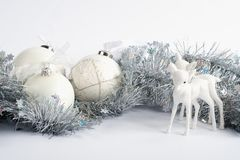 Some decorative white christmas balls. Christmas is the time of the year when we decorate our home and work place with christmas balls and ornaments. The scene royalty free stock images