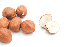 Some delicious hazelnuts on white. Some delicious cobnuts closeup on white background stock image