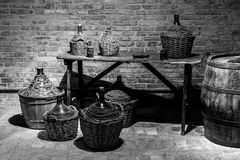 Some demijohns and barrels of various sizes inside a typical Ita Royalty Free Stock Images