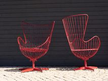 Some designer chairs in front of a black background stock photography