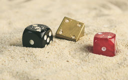 Some dices in the sand dunes.  Royalty Free Stock Image