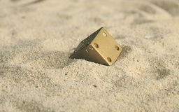Some dices in the sand dunes. Some dices buried in the sand dunes Stock Photography